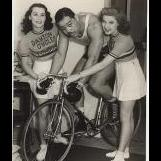 Joe Louis being presented with a bike at Dayton Cycles.jpg